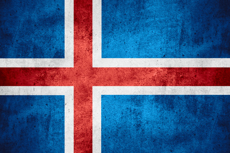 icelandic flag: flag of Iceland or Icelandic banner on rough pattern texture background Stock Photo