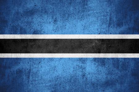 botswanan: flag of Botswana or Botswanan banner on rough pattern texture background