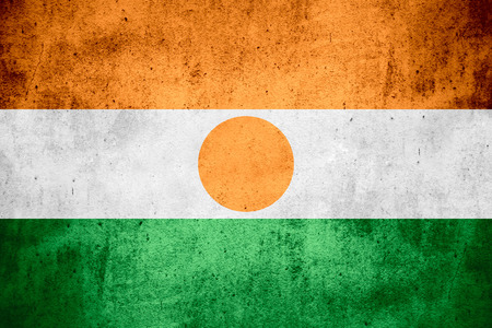niger: flag of Niger or Nigerian on rough pattern texture background Stock Photo