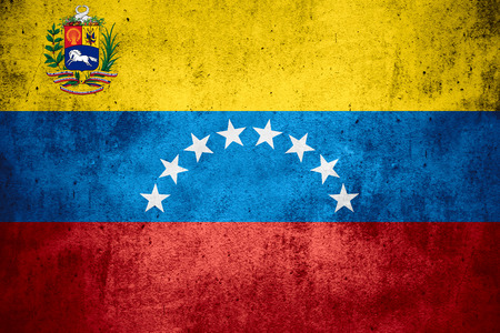 venezuelan: flag of Venezuela or Venezuelan on rough pattern texture background Stock Photo