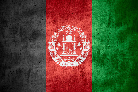 afghan flag: flag of Afghanistan or Afghan banner on rough pattern texture background