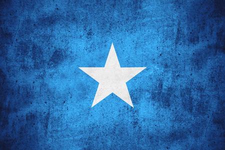 somali: flag of Somalia or Somali banner on rough pattern texture background Stock Photo