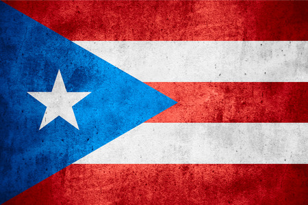 puerto rican: flag of Puerto Rico or Puerto Rican on rough pattern texture background Stock Photo
