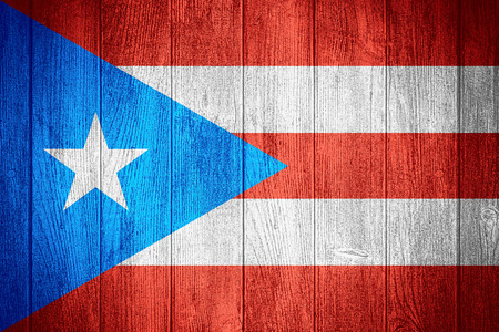 puerto rican flag: Puerto Rico flag or Puerto Rican banner on wooden boards background Stock Photo