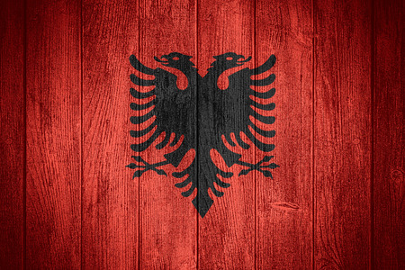 albanian: Albania flag or Albanian banner on wooden boards background Stock Photo