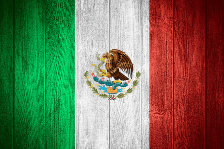 Mexico flag or Mexican banner on wooden boards background