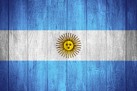 argentinian: Argentina flag or Argentinian banner on wooden boards background