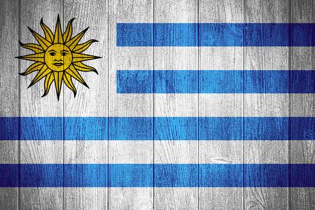 uruguay flag: Uruguay flag or Uruguayan banner on wooden boards background Stock Photo