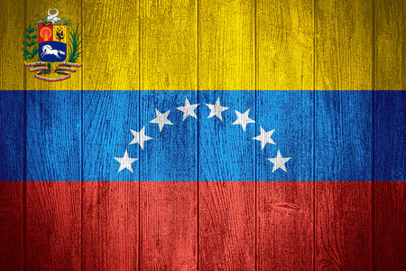 venezuela flag: Venezuela flag or Venezuelan banner on wooden boards background
