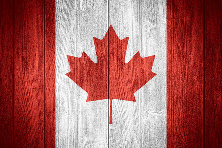 canadian state flag: Canada flag or Canadian banner on wooden boards background
