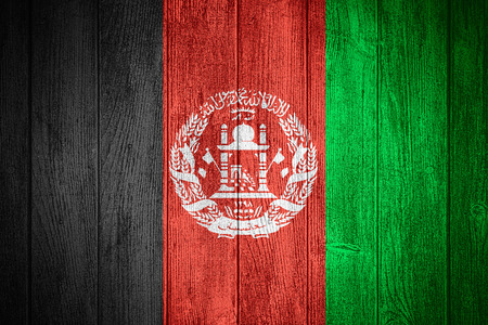 afghan flag: Afghanistan flag Afghan or banner on wooden boards background