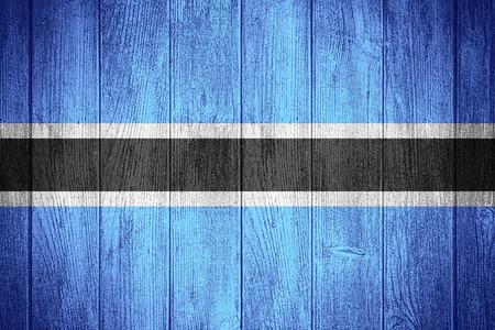 botswanan: Botswana flag or Botswanan banner on wooden boards background Stock Photo