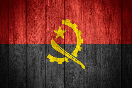 Angola flag or Angolan banner on wooden boards background