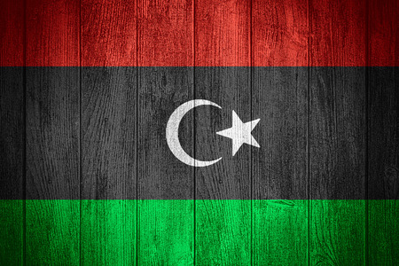 libyan: Libya flag or Libyan banner on wooden boards background Stock Photo