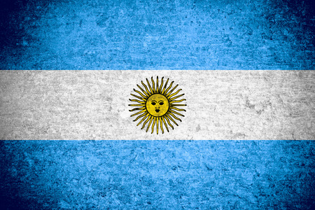 argentinian flag: flag of Argentina or  Argentinian banner on old metal texture background Stock Photo
