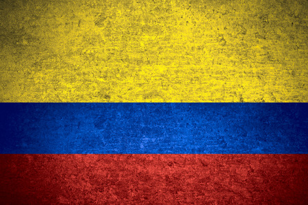colombian: flag of Colombia or  Colombian banner on old metal texture background Stock Photo