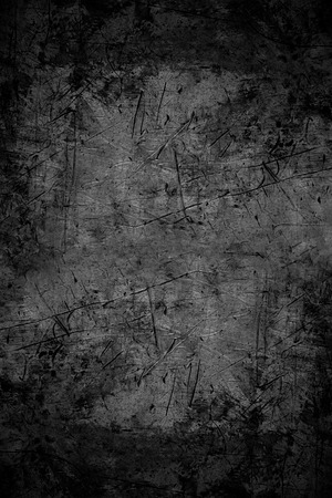 scratched: black abstract background or scratched metal texture