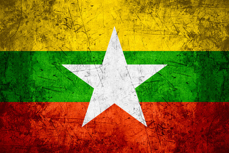 burmese: flag of Burma or Burmese banner on rough pattern metal background, Myanmar