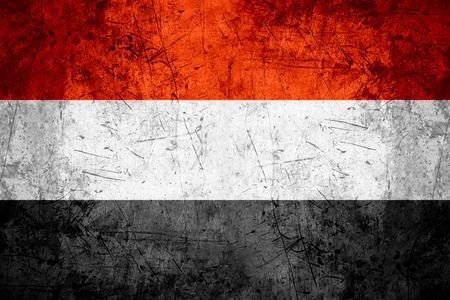 yemen: flag of Yemen or Yemeni banner on rough pattern metal background Stock Photo