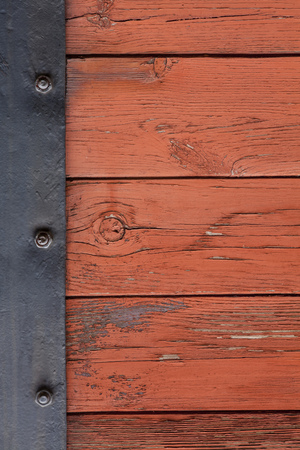 margen: old wooden boards background with metal plate margin