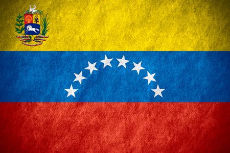 venezuela: flag of Venezuela or Venezuelan banner on canvas texture