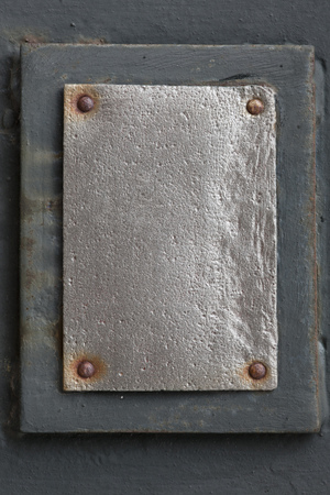 rivets: silver metal plate with rivets on grey background Stock Photo