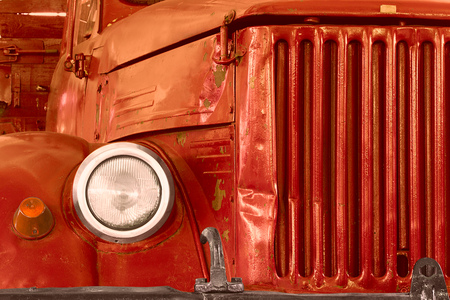 grille: front of old red lorry with grille and reflector