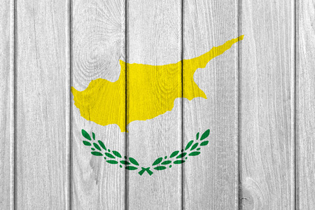 cypriot: flag of Cyprus or Cypriot banner on wooden background