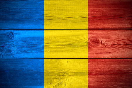 romanian: flag of Romania or Romanian banner on wooden background Stock Photo