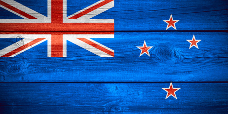 bandera de nueva zelanda: flag of New Zealand or banner on wooden background Foto de archivo