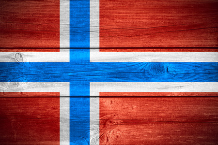 norwegian: flag of Norway or Norwegian banner on wooden background