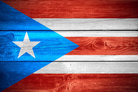 puerto rican flag: flag of Puerto Rico or Puerto Rican banner on wooden background Stock Photo