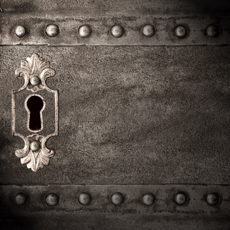vintage keyhole in old iron doors, abstract background Stock Photo