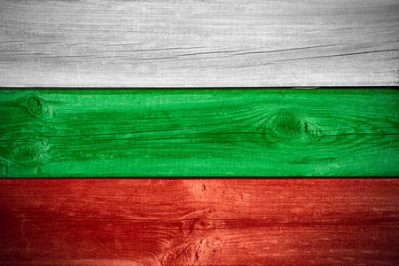 bulgarian: flag of Bulgaria or Bulgarian banner on wooden background