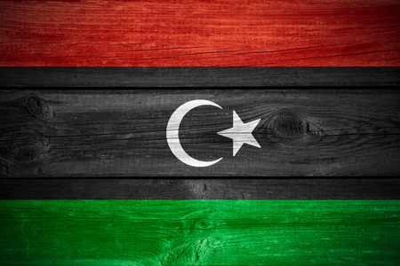 libyan: flag of Libya  or Libyan banner on wooden background