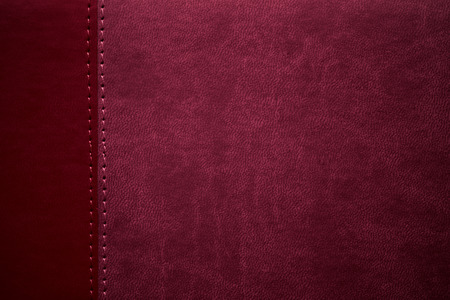 margen: textura de cuero roja con la costura en el margen