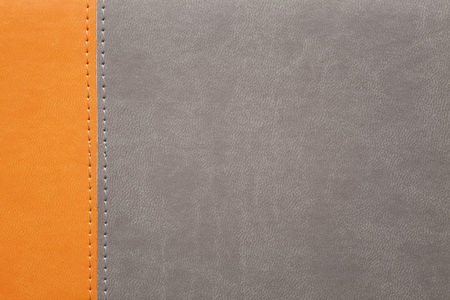 orange texture: orange and grey leather texture with seam at margin