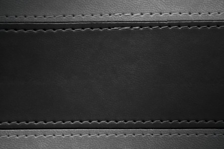 margins: black and grey leather texture with seam at margins Stock Photo