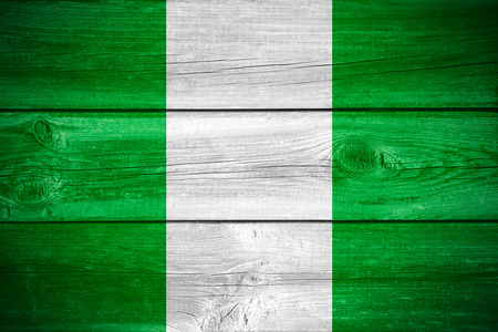 flag banner: flag of Nigeria  or Nigerian banner on wooden background Stock Photo