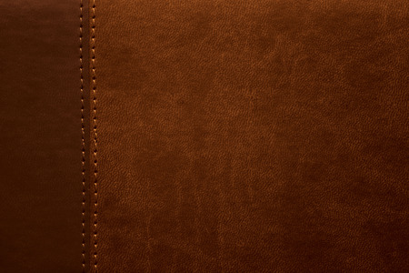 texture en cuir marron avec couture à la marge