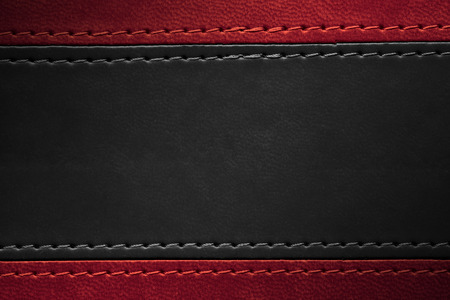 red and black leather texture with seam at margins