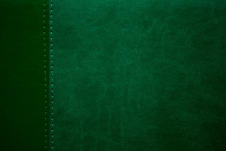 margen: textura de cuero verde con la costura en el margen Foto de archivo