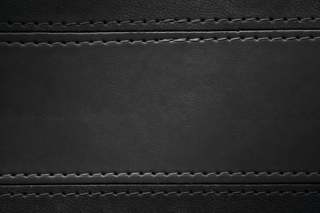seam: black leather texture with seam at margins Stock Photo
