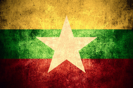 burmese: flag of Burma or Burmese banner on rough pattern texture vintage background, Myanmar Stock Photo