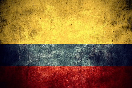 colombian: flag of Colombia or Colombian banner on rough pattern texture vintage background Stock Photo