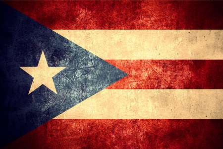 puerto rican flag: flag of Puerto Rico or Puerto Rican banner on rough pattern texture vintage background Stock Photo