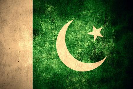pakistani pakistan: flag of Pakistan or Pakistani banner on rough pattern texture vintage background