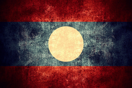 lao: flag of Laos or Lao banner on rough pattern texture vintage background Stock Photo