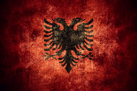albanian: flag of Albania or Albanian banner on rough pattern texture vintage background