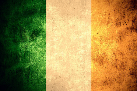 flag of Ireland or Irish banner on rough pattern texture vintage background Banco de Imagens